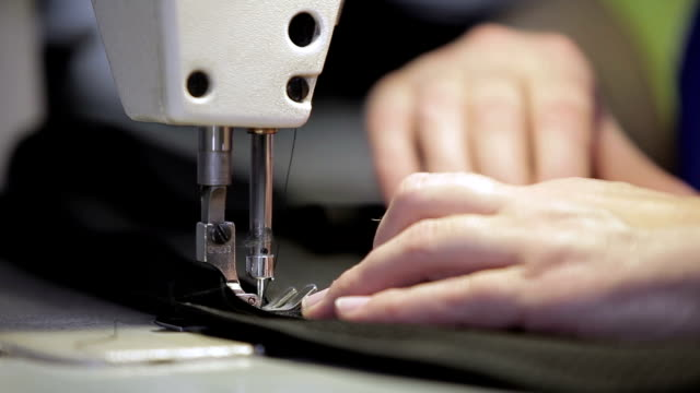 Close up of a sewing machine sews. video