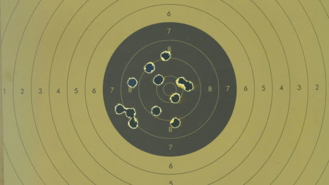 Close up of a shooting target with backlit bullet holes