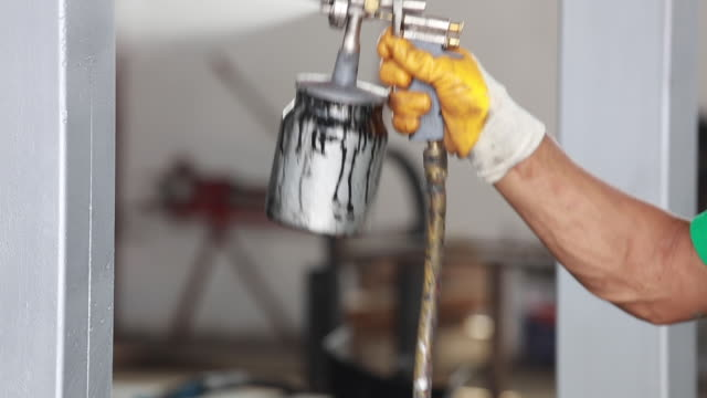 Close up of a spray paint gun