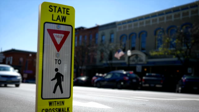 Close up of a state law crosswalk sign in small american town video