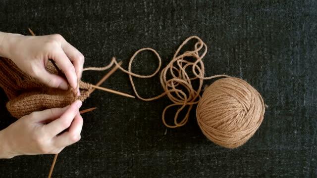 Close up of a woman knitting a sock