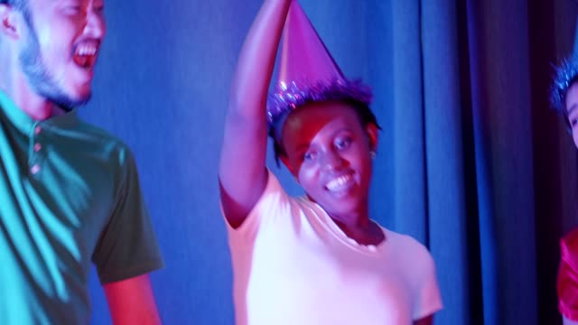 Close up of African woman dancing with friends at her birthday party video