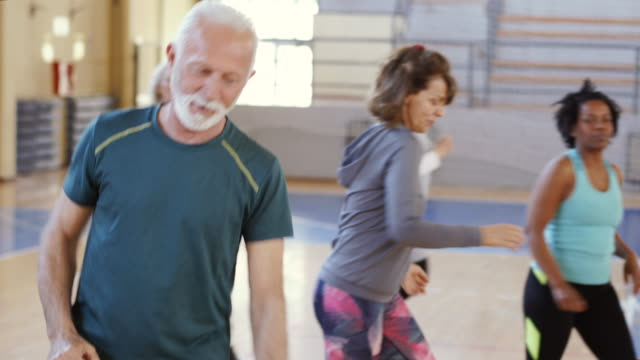 Close up of an active senior man dancing in gym Close up of an active senior man dancing in gym dance studio stock videos & royalty-free footage