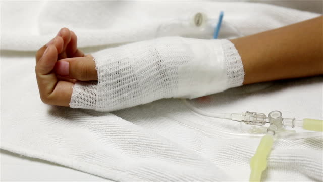 Close up of an iv drip in patient's hand video