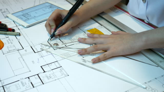 Close up of Architect's hand checking drawing work, 4K(UHD) video