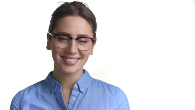 Close Up Of Attractive Woman In Glasses Smiles Into Camera - video
