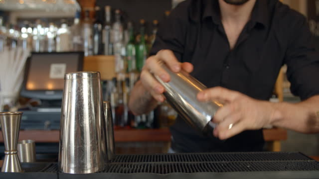 Close Up Of Barman Mixing Cocktail On Counter video