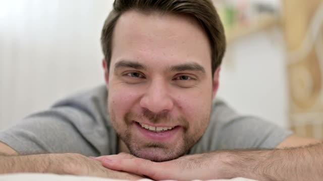 Close up of Beard Young Man Smiling at Camera in Bed - vídeo