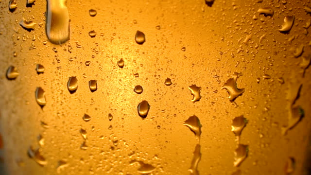 Close up of beer bubbles and water drops