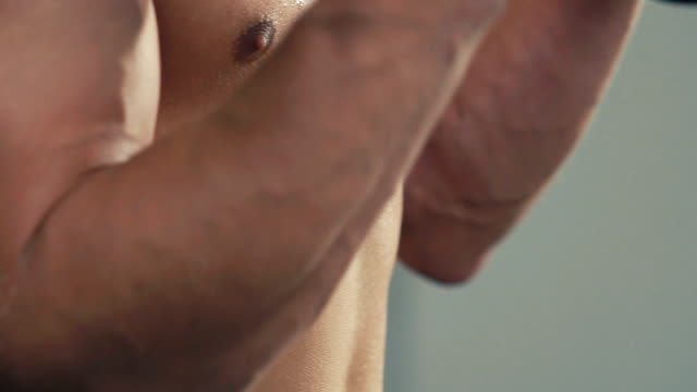 Close up of bodybuilder training with the weight in gym. Slowly video
