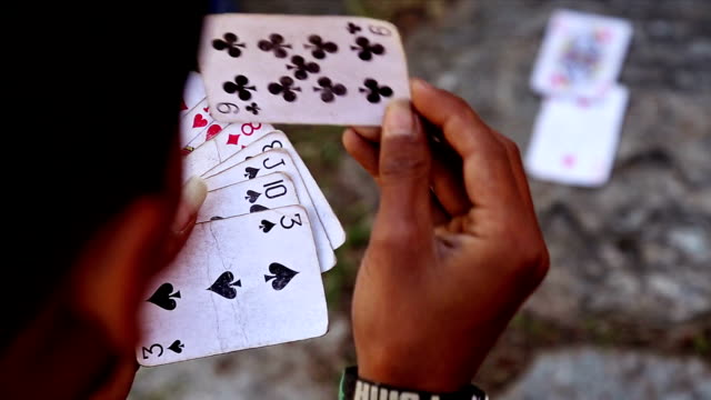 Close up of Boy Holding Playing Cards Stock. video