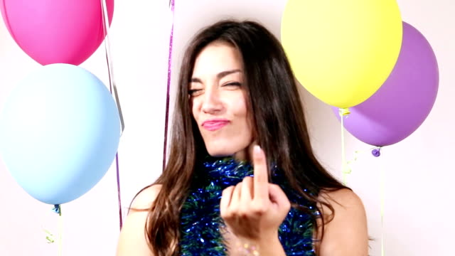 Close up of brunette woman playing with props in party photo booth video