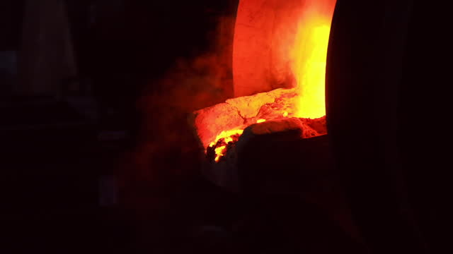 Close up of burning wood fire in blacksmith furnace. Stock footage. Side view of pushing red hot coals out of the furnace with an iron poker on black background Close up of burning wood fire in blacksmith furnace. Stock footage. Side view of pushing red hot coals out of the furnace with an iron poker on black background. hot pockets stock videos & royalty-free footage