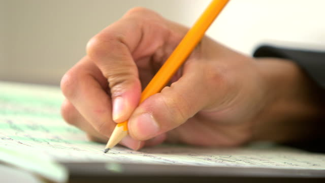Close up of business woman writing with pencil video