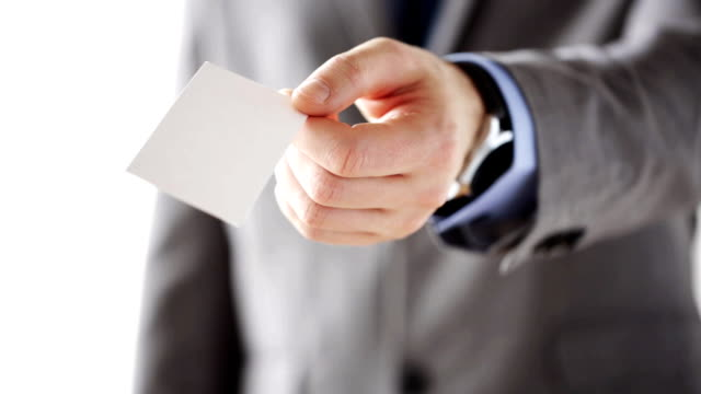 close up of businessman hand giving white blank visiting card - business card stock videos & royalty-free footage