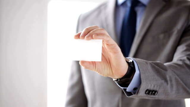 close up of businessman hand showing white blank visiting card business, people and office concept - close up of businessman hand in suit showing white blank visiting card business card stock videos & royalty-free footage