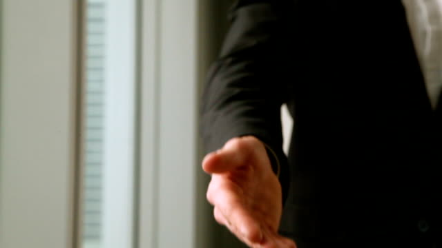 Close up of businessman reaching out hand for shaking, handshake video