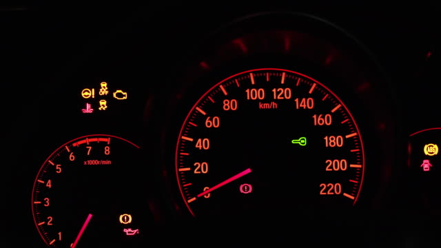 Close up of car dashboard with visible speedometer