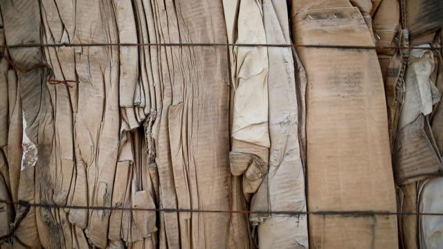 close up of cardboards, stacked and ready for recycle - odzyskiwanie i przetwarzanie surowców wtórnych filmów i materiałów b-roll