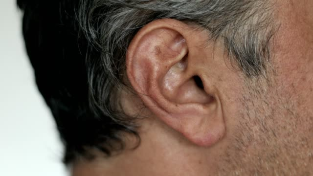 Close up of Caucasian man ear - listening Close up of Caucasian man ear - listening ear stock videos & royalty-free footage