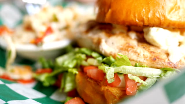 Close up of chicken sandwich on restaurant table video