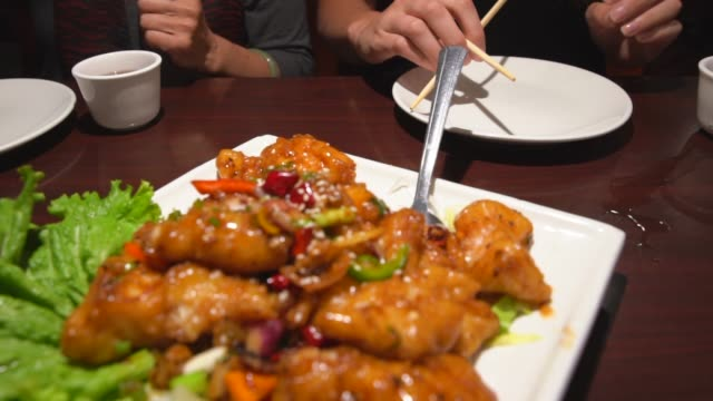 close up of Chinese food being served at a restaurant video