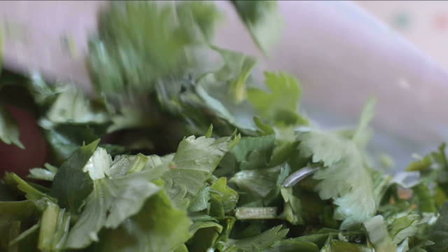 Close up of cilantro chopped with a chef knife video