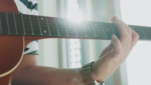 close up of composer man is creating music while playing guitar - classical architecture stock videos & royalty-free footage