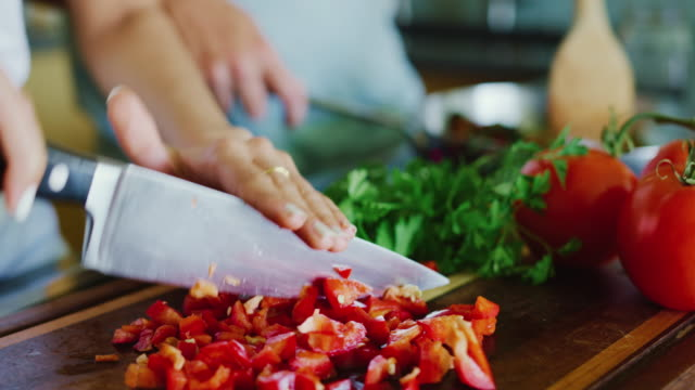 Close Up of Couple Cooking in the Kitchen Close up of couple chopping fresh vegetables cooking in the kitchen wife stock videos & royalty-free footage
