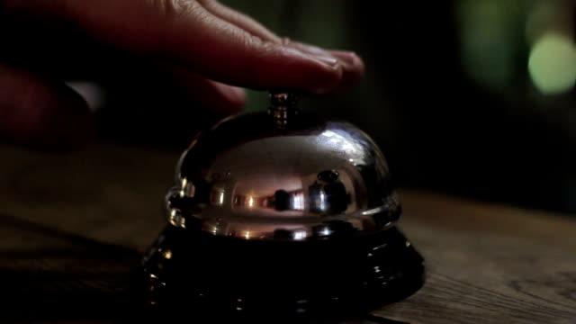 Close up of desk bell being rung video