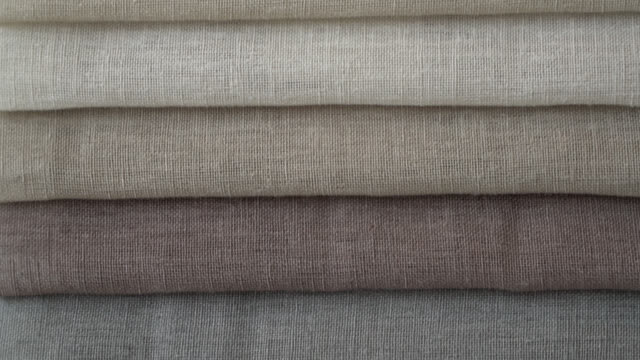 Close up of different textile colors at a fabric store Close up of different textile colors at a fabric store fabric swatch stock videos & royalty-free footage