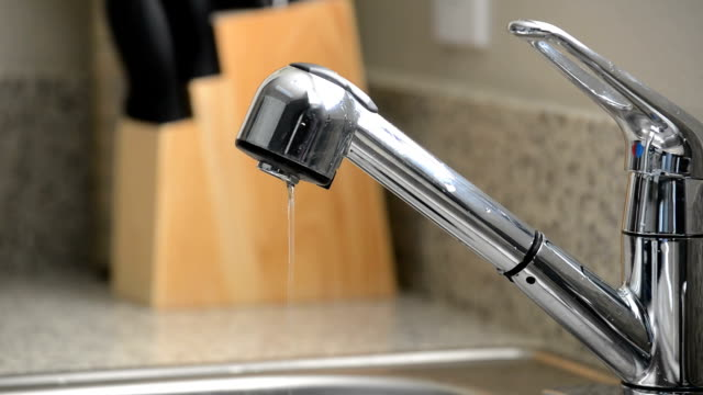 Close up of dripping kitchen sink faucet video