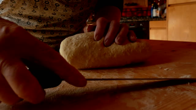 close up of elderly woman's hand kneading - cucina mediterranea video stock e b–roll