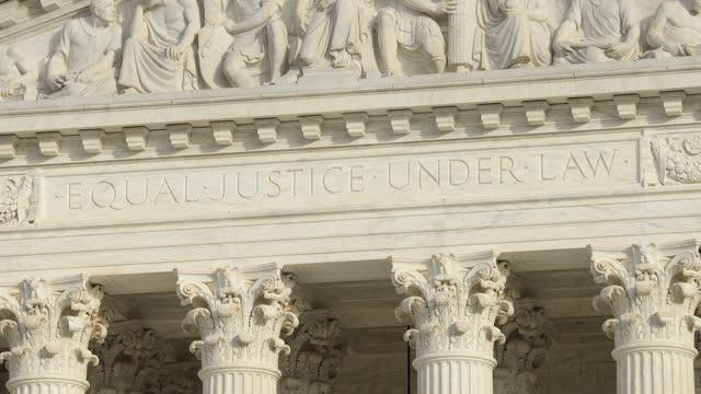 Close up of 'Equal Justice Under Law' engraved on West Pediment of US Supreme Court - D.C.