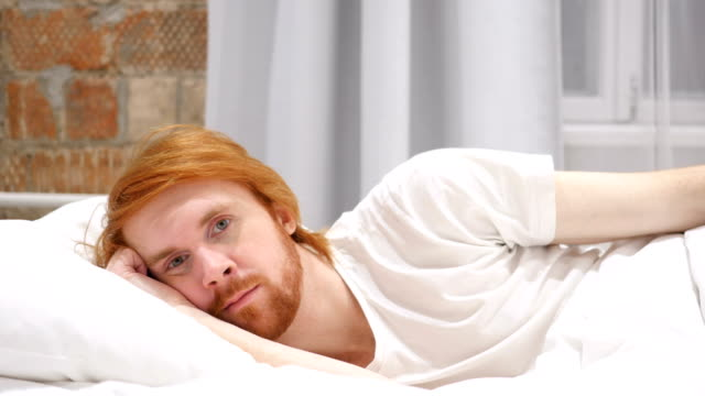 Close Up of Face of Young Redhead Beard Man Lying in Bed video