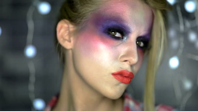 Close up of face with multicolored make-up Artistic colorful make-up with glitter, beauty portrait eyeshadow stock videos & royalty-free footage