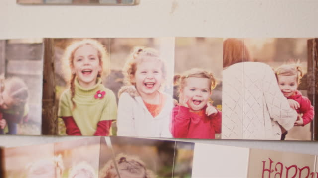 Close up of family photos on a fridge video