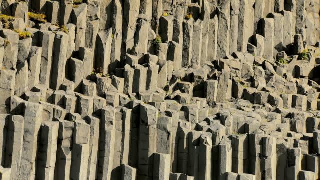 close up of famous basalt rocks on black sand beach Reynisfjara in Iceland video