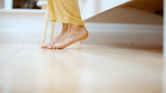 Close up of female feet getting out of bed in the morning. Close up of female feet getting out of bed in the morning. human foot stock videos & royalty-free footage