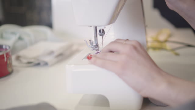 4K: Close Up Of Female Hands On Sewing Machine. video
