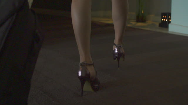 close up of female legs of a worker walking in the hotel. the woman is wearing formalwear and shoes on high heels. - high heels stock videos & royalty-free footage