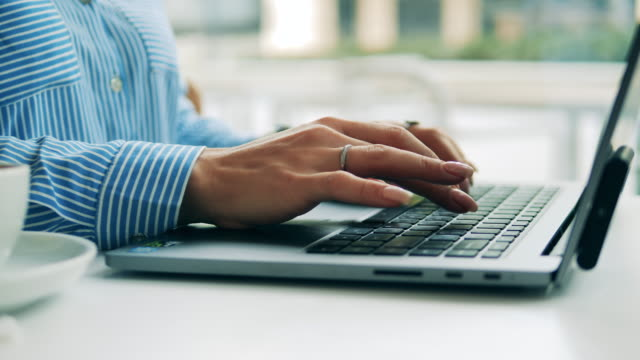 Close up of female manicured hands typing on a laptop Close up of female manicured hands typing on a laptop. 4K human settlement stock videos & royalty-free footage