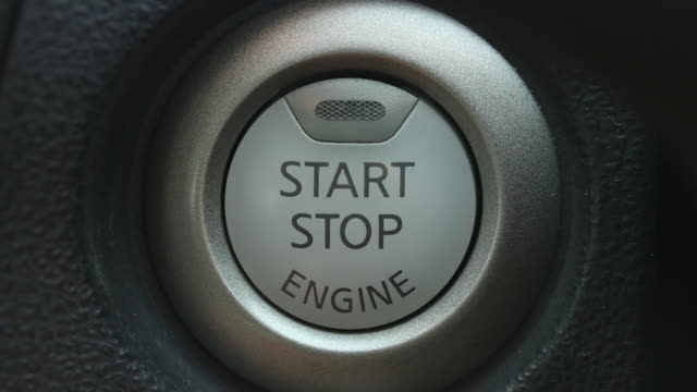 Close up of finger pushing start engine button in a car Close up of finger pushing orange start engine button in a car effortless stock videos & royalty-free footage