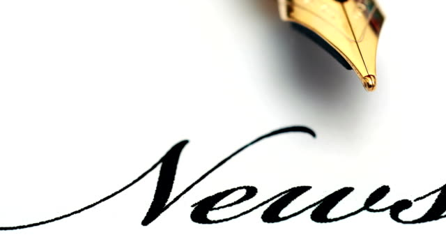 close up of fountain pen on news text - newsletter video stock e b–roll