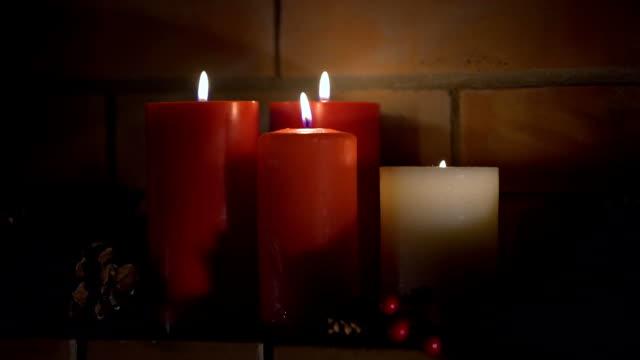 vídeos y material grabado en eventos de stock de primer plano de cuatro velas encendidas - advent
