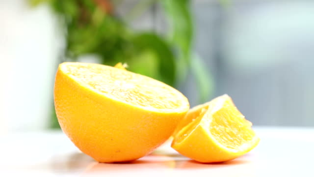 Close up of fresh orange on white table. video