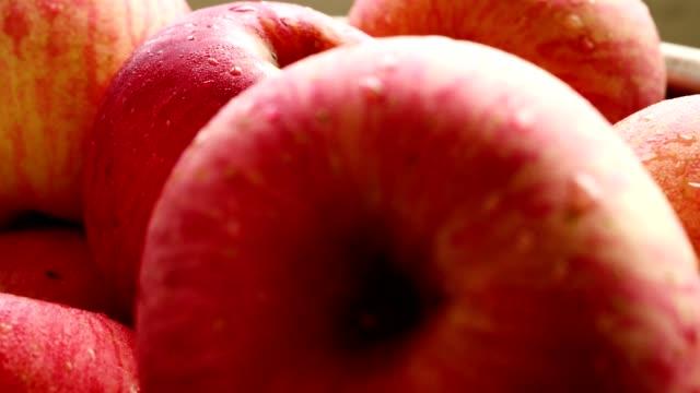 close up of fresh red apples in the basket. - jabłko filmów i materiałów b-roll