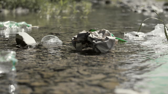 close up of garbage in the river - earth day stock videos & royalty-free footage