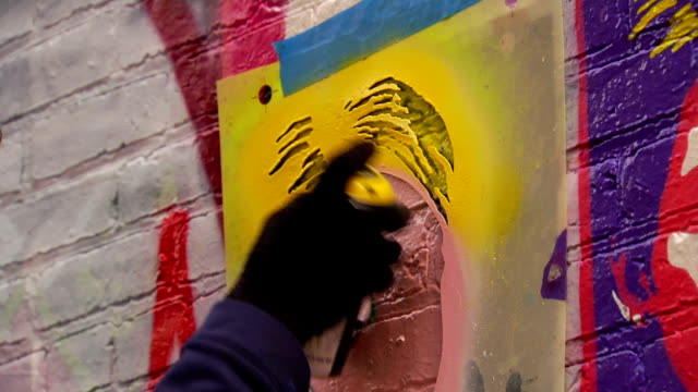 Close Up of Graffiti Artist Spraying Stencil video