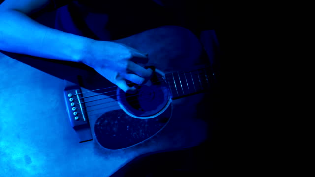 Close up of guitar player on stage at night Close up of guitar player on stage at night guitar stock videos & royalty-free footage